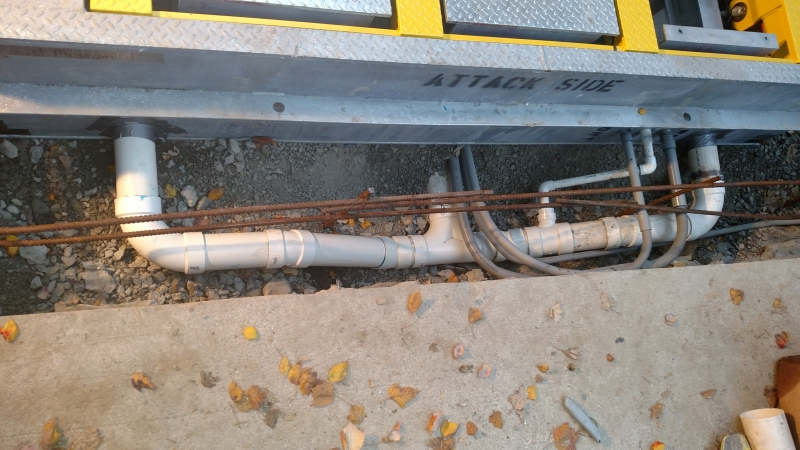 Setting the barrier, tying in the drain, installing rebar, and tying in the conduit